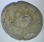 Fishing weight with fossil